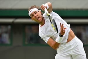 And another one from Wimbledon: Spain's Rafael Nadal serves against Belgium's Steve Darcis during their men's first round match on day one of the 2013 Wimbledon Championships tennis tournament.
