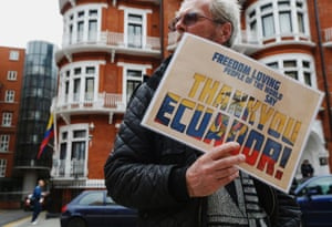 "A supporter of Edward Snowden holds a sign that reads ""Thank You Ecuador"", outside the Embassy of Ecuador in London June 24, 2013."
