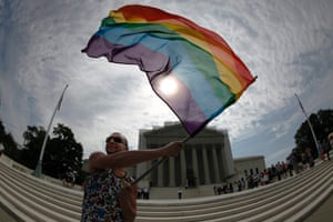 A fish-eye lens photo of gay marriage supporter Vin Testa waving a rainbow flag in anticipation of U.S. Supreme Court rulings in the cases against California's gay marriage ban known as Prop 8 and the 1996 federal Defense of Marriage Act (DOMA), outside the court building in Washington.