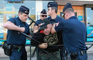 A man is arrested by police officers after demonstrating against the anti gay marriage rally in front of Bayonne sub prefecture, southwestern France.