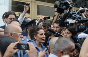 """Daniela Santanche, a member of Silvio Berlusconi's People of Freedom party (PDL), speaks to the media after the Silvio Berlusconi was sentenced to seven years in prison, outside the Justice Building in Milan, Italy. Former Italian Premier Silvio Berlusconi has been sentenced to seven years in prison for paying an underage teen for sex during his """" Bunga Bunga"""" parties near Milan."""