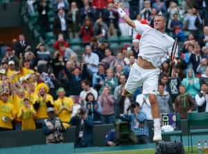 Lleyton Hewitt of Australia celebrates after defeating Stanislas Wawrinka of Switzerland in their men's singles tennis match at the Wimbledon Tennis Championships, in London.