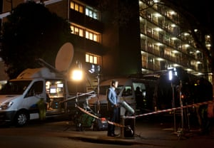 """A television presenter reports live from outside an entrance at the Mediclinic Heart Hospital where former South African President Nelson Mandela is being treated in Pretoria. South Africa's president Jacob Zuma said a critically ill Nelson Mandela was """"asleep"""" when he visited the 94-year-old in a hospital, and he urged the country to pray for Mandela, describing him as the """"father of democracy""""."""