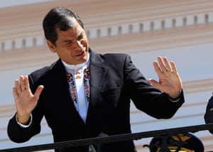 Ecuadorean President Rafael Correa smiles at the crowd during a military act at the Presidential Palace in Quito. Correa announced that his government will decide with 'absolute sovereignty' on the political asylum for former CIA technical contractor Edward Snowden, accused of espionage by the US that demands his extradition.