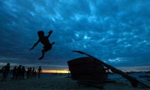 A boy plays at a beach in Fortaleza, Brazil.