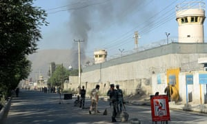 Smoke rises from the gate of the presidential palace in Kabul.