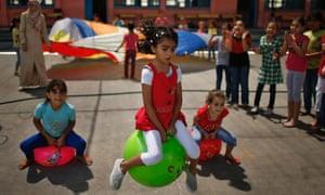 Palestinian girls play during UN run summer fun games weeks in Gaza City.