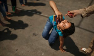 Palestinian girl Alaa Soboh, 10, participates in a game collecting clips. Thousands of children from the Gaza Strip spend part of their holidays at the camps.