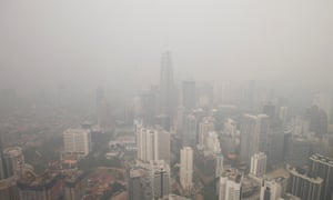 The haze covered capital of Malaysia, Kuala Lumpur. The smog spreads north as Indonesian planes continue to control raging forest fires.