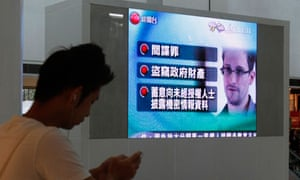 A monitor broadcasting news of Edward Snowden, in Hong Kong