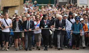 Fans arrive at the Wimbledon Championships at The All England Lawn Tennis and Croquet Club.
