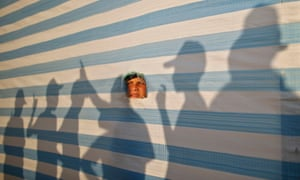 A Palestinian boy looks on through a sheet as he takes part in a summer camp organized by the Hamas movement in Gaza City.