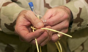 Guantanamo bay doctor holds feeding tube used to feed detainees on hunger strike