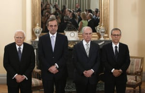 Greece's Prime Minister Antonis Samaras (2nd L) and Greek President Karolos Papoulias (L) attend a swearing in ceremony at the Presidential Palace in Athens June 25, 2013.