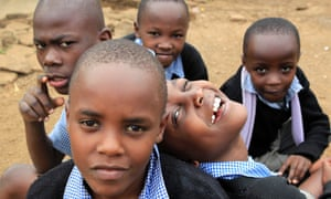 Children pose for a photograph outside their classroom in Nairobi. A nationwide strike by Kenyan teachers demanding a salary increase left most of the country's schools closed today.