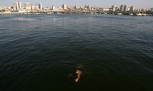 A Palestinian man swimming in the sea of Gaza City today.