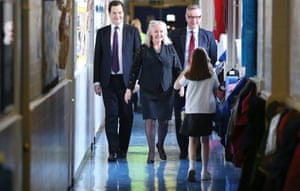 No running! Chancellor George Osborne walks with head teacher Amanda Phillips and Education Secretary Michael Gove during a visit to Old Ford Primary School in London.