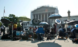 Television news crews gather in front of the US supreme court in Washington as justices delivered their ruling on the Voting Rights Act.