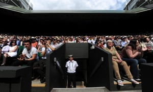 Spectators in the Centre Court as Novak Djokovic of Serbia takes on Florian Mayer of Germany during their first round match in the 2013 Wimbledon Championships.