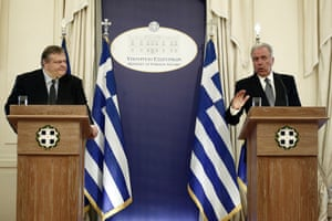 Outgoing Greek Foreign Minister Dimitris Avramopoulos (R) speaks during the delivery and reception ceremony as newly appointed Greek government Vice-President and Foreign Minister Evangelos Venizelos (L) looks on, in Athens, Greece, 25 June 2013.