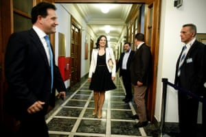 Greek Minister of Tourism Olga Kefalogianni (centre) and newly appointed Shipping Minister Adonis Georgiadis (left) arrive for a cabinet meeting at the Greek Parliament in Athens, Greece, 25 June 2013.