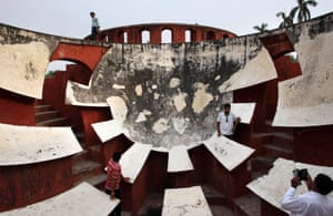 An Indian man poses for a photograph at Jantar Mantar, an outdoor observatory, in New Delhi, India. The Jantar Mantar is an astronomical observatory built in the eighteenth century by Maharajah Jai Singh II of Jaipur.