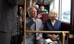 Prince Charles and Camilla, Duchess of Cornwall take a short ride on a New Bus for London during a visit to WrightBus in Ballymena, County Antrim, Northern Ireland.