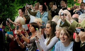 People take a pictures of the Royal bus passengers. Perhaps he was pointing at them.