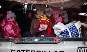 A Syrian refugee baby cries as she arrives at a camp