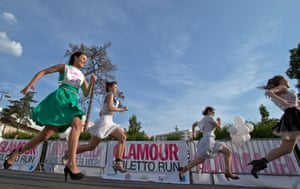 Legging it: Women compete in a high heels race organized by a fashion magazine in Bucharest, Romania. Photograph: Vadim Ghirda/AP