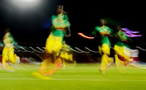 A long exposure picture shows Mali players warming up before the FIFA Under 20 World Cup 2013 Group D soccer match between Mali and Greece at the Gaziantep Kamil Ocak stadium in Gaziantep, Turkey.