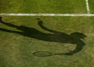 A shadow of Simone Bolelli of Italy as he prepares to serve during his Gentlemen's Singles first round match against Grigor Dimitrov of Bulgaria (unseen) at Wimbledon. Photograph: Dan Kitwood/Getty Images