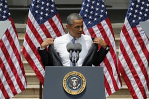 """""""Is it getting a bit warmer out here?"""": President Barack Obama removes his jacket before speaking about climate change, at Georgetown University in Washington. The president is proposing sweeping steps to limit heat-trapping pollution from coal-fired power plants and to boost renewable energy production on federal property, resorting to his executive powers to tackle climate change and sidestepping the partisan gridlock in Congress. Photograph: Charles Dharapak/AP"""