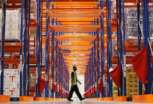A worker walks through the new Sainsbury's distribution centre at Thameside in east London. The 30 million GB pounds, 250,000 square foot facility will support 200 Sainsbury's Local stores in London and south east England, and when fully operational will provide 600 jobs.