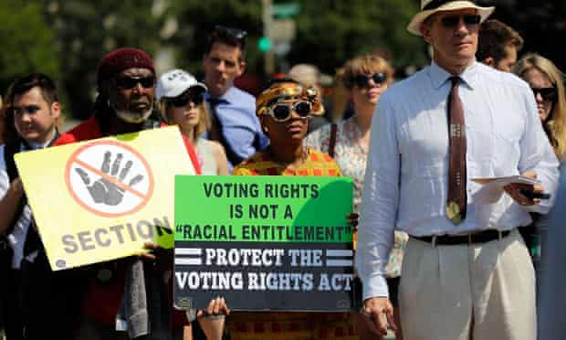 Supporters of the Voting Rights Act listen to speakers outside the Supreme Court