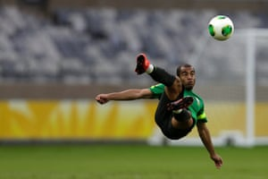 Brazil's national soccer team player Lucas kicks the ball during a training session in Belo Horizonte. Brazil will play against Uruguay in their Confederations Cup semi-final soccer match on Wednesday.