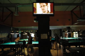 A television screen shows former U.S. spy agency contractor Edward Snowden during a news bulletin, at a billiards room in St. Petersburg June 25, 2013.