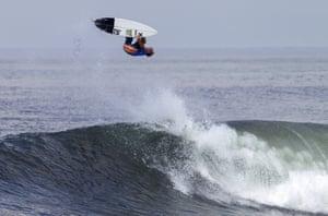 John John Floremce of Hawaii surfs in Denpasar, Bali, Indonesia.