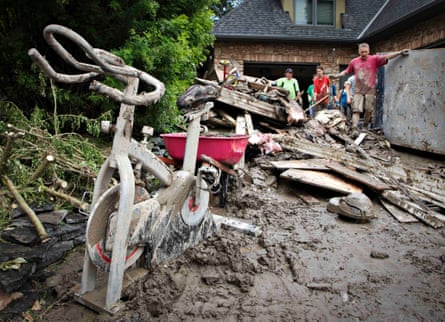 A mud-covered exercise bike sits outside a home as residents clean up after floods in Calgary, Alberta. Canada's oil capital, Calgary, started the slow process of cleaning up its downtown in the aftermath of record-breaking floods, with many business owners returning for the first time to properties they were forced to leave last week.