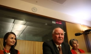 Tony Windsor resigns with his family this morning. The Global Mail.