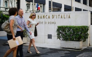 People walk in front of the Bank of Italy in Rome June 26, 2013.