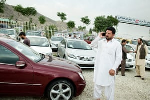 Kabul's new rich: A customer at a Kabul car dealer's.