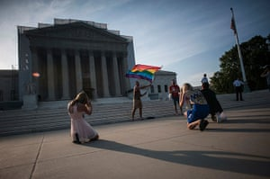 Gay marriage : A demonstrator waves a flag while awaiting decisions at the US Supreme Cour