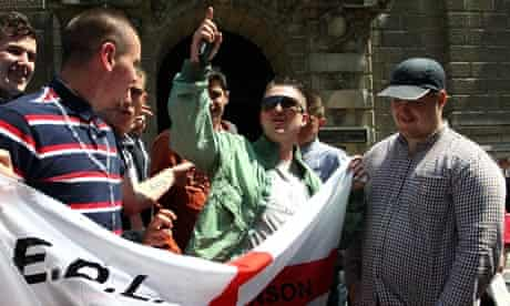 English Defence League leader, Tommy Robinson, (centre)