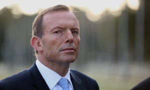 The Leader of the Opposition Tony Abbott waits to go onto morning TV on the lawns outside Parliament House. The Global Mail.
