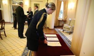 Arranging the official papers for the swearing in ceremony at Government House. The Global Mail.