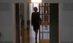 The former Prime Minister Julia Gillard walks into the chamber for the first time as a backbencher to listen to Rob Oakeshott's valedictory speech in Parliament House. The Global Mail.