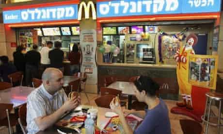Israelis eat at a kosher McDonald's restaurant  in Tel Aviv