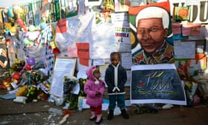 Children pose outside the Medi-Clinic Heart Hospital where former South African President Nelson Mandela is being treated in Pretoria.