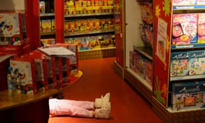 Shop till you drop: A young girl lies on the floor of Hamleys toy store.